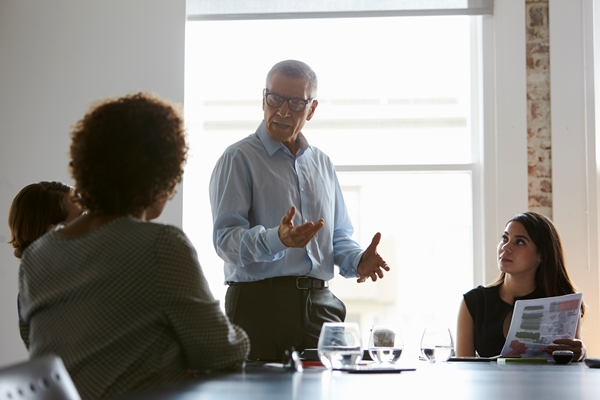 Group of people discussing inside a meeting room