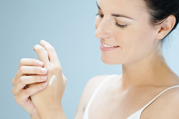 Woman applying product on her hands