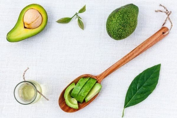 Essential oils how to use and get benefits of essential oils avocado essential oil chunks and fruits in white background mightylinksfo