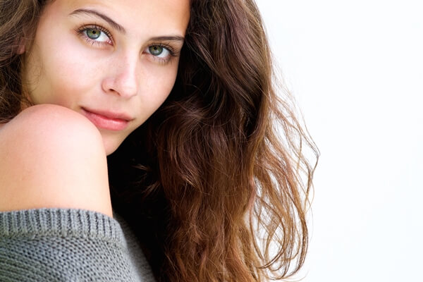Attractive woman smiling with her beautiful eyes that have long eyelashes