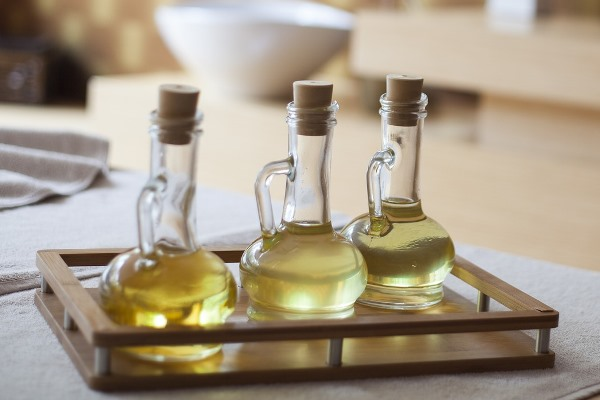 Castor oil for skin massage in decanters