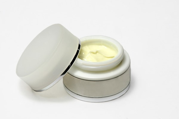 White face cream on a white plastic container