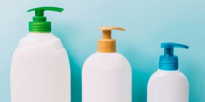 Shampoo in white plastic containers