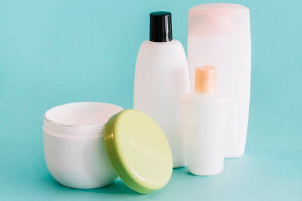 Different types of skin and hair products in different containers